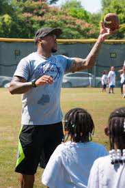 Football coach and kids